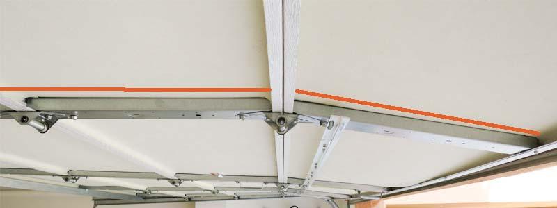 sagging garage door repair